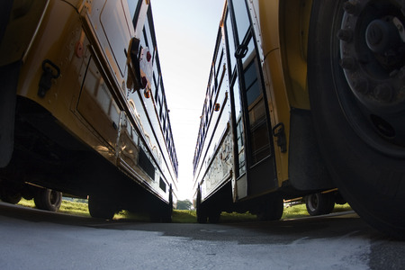 school year: School buses prepare for another school year Stock Photo