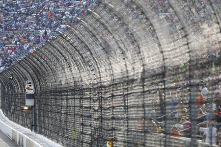va: Martinsville, VA - Oct 30, 2016: A NASCAR Official holds the caution flag during the Goodys Fast Relief 500 at the Martinsville Speedway in Martinsville, VA.
