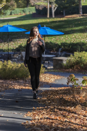 coed: A brunette model enjoying the fall weather outdoors Stock Photo