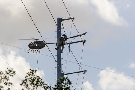 aircrew: Key Largo, FL - Oct 17, 2016: Aerial crews work on repairs from Hurricane Matthew that hit the Florida Keys in early October. Editorial
