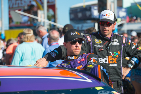 nscs: Homestead, FL - Nov 20, 2016: Denny Hamlin, driver of the #11 FedEx Express Toyota, gets ready for action  during the Ford EcoBoost 400 weekend at the Homestead-Miami Speedway in Homestead, FL.