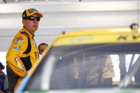 Homestead, FL - Nov 19, 2016: Kyle Busch (18) hangs out in the garage during practice for the Ford EcoBoost 400 at the Homestead-Miami Speedway in Homestead, FL. Editorial