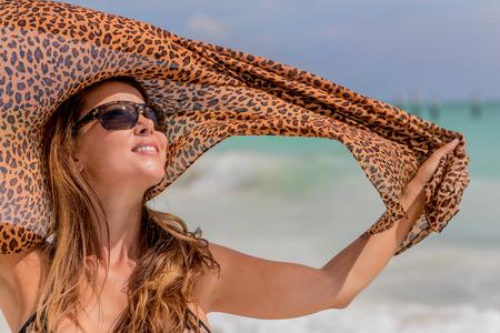 woman bath: A hispanic brunette model enjoying the beach