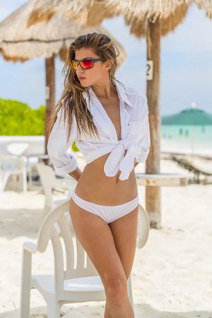 coed: A hispanic brunette model enjoying the beach