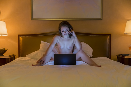 A young female indulging in cybersex Stock fotó
