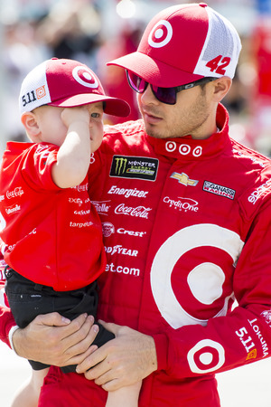 March 12, 2017 - Las Vegas, Nevada, USA:  Kyle Larson (42) holds his son, Owen, before the start of the Kobalt 400 at Las Vegas Motor Speedway in Las Vegas, Nevada.