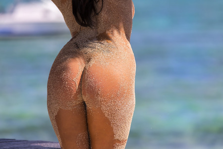 Sexy sandy woman buttocks on a Caribbean beach Stock Photo