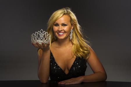 coed: A beauty queen posing in a studio environment Stock Photo