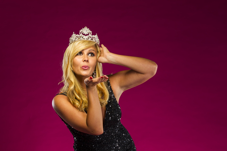 prom queen: A beauty queen posing in a studio environment Stock Photo