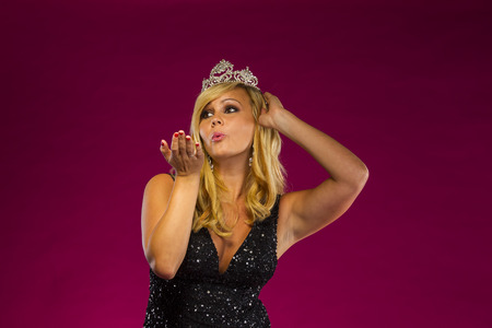 A beauty queen posing in a studio environment Stock Photo