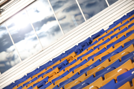 venue: Rows of colored seats at an outdoor venue