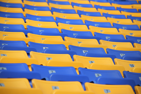 Rows of colored seats at an outdoor venue