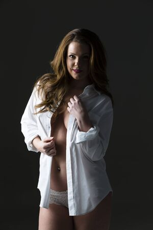 Brunette model posing in a studio environment