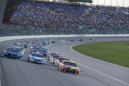 Race for the lead during the Go Bowling 400 at Kansas Speedway in Kansas City, Kansas.