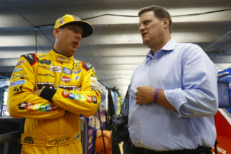 kyle: May 25, 2017 - Concord, NC, USA: Kyle Busch (18) and Steve ODonnell hang out in the garage during qualifying for the Coca Cola 600 at Charlotte Motor Speedway in Concord, NC. Editorial