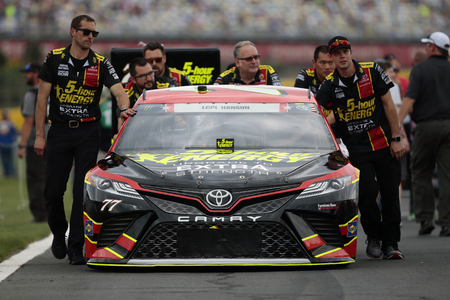 May 28, 2017 - Concord, NC, USA: The crew of  Erik Jones (77) pushes his car to the grid before the Coca Cola 600 at Charlotte Motor Speedway in Concord, NC. Editorial