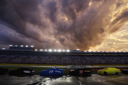 May 28, 2017 - Concord, NC, USA: The Monster Energy NASCAR Cup Series teams sit under a rain delay during the Coca Cola 600 at Charlotte Motor Speedway in Concord, NC. Editorial