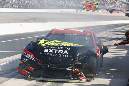 June 04, 2017 - Dover, DE, USA: Erik Jones (77) gets involved in a wreck during the AAA 400 Drive for Autism at Dover International Speedway in Dover, DE.
