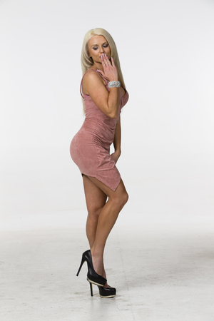 adultery: Blonde model posing in a studio environment