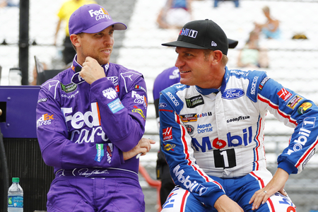 indianapolis: July 22, 2017 - Speedway, IN, USA: Denny Hamlin (11) and Clint Bowyer (14) hang out on pit road before qualifying for the Brantley Gilbert Big Machine Brickyard 400 at Indianapolis Motor Speedway in Speedway, IN. Editorial