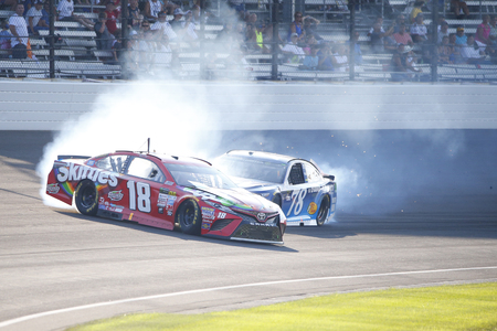 July 23, 2017 - Speedway, Indiana, USA: Kyle Busch (18) and Martin Truex Jr. (78) collide in turn 1 during the Brantley Gilbert Big Machine Brickyard 400 at Indianapolis Motor Speedway in Speedway, Indiana.