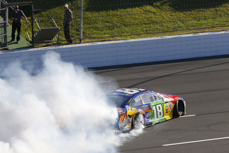 July 30, 2017 - Long Pond, Pennsylvania, USA: Kyle Busch (18) takes the checkered flag and wins the Overtons 400 at Pocono Raceway in Long Pond, Pennsylvania. Editorial