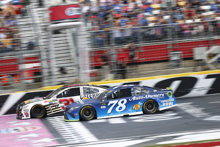 October 08, 2017 - Concord, North Carolina, USA: Martin Truex Jr (78) battles for position during the Bank of America 500 at Charlotte Motor Speedway in Concord, North Carolina.