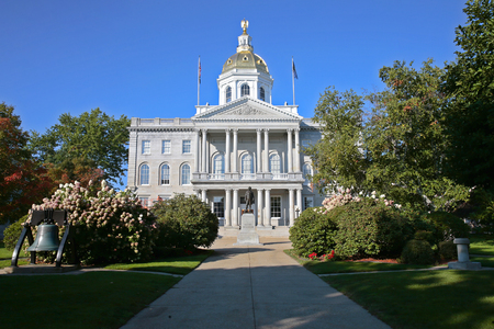 The New Hampshire State House, located in Concord at 107 North Main Street, is the state capitol building of New Hampshire. The capitol houses the New Hampshire General Court, Governor and Executive Council. The building was constructed on a block framed by Park Street (named in honor of the architect, Stuart James Park) to the north, Main Street to the east, Capitol Street to the south, and North State Street to the west.