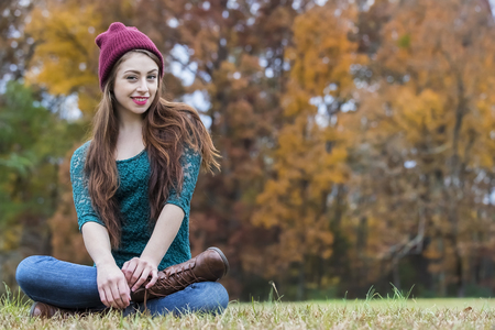 A beautiful brunette model enjoying the autumn weather Stock Photo