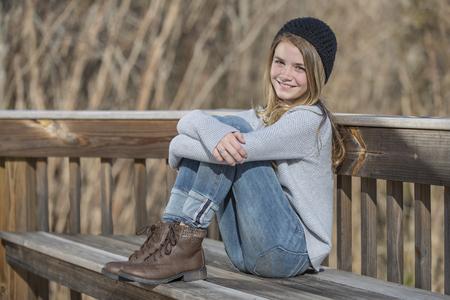 A beautiful young teenage blonde girl enjoying a beautiful day.