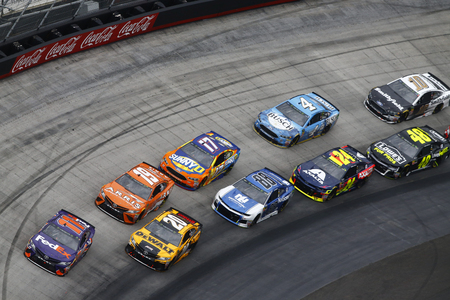 April 15, 2018 - Bristol, Tennessee, USA: Denny Hamlin (11), Erik Jones (20), Daniel Suarez (19), Alex Bowman (88), Ricky Stenhouse, Jr (17), William Byron (24), Kevin Harvick (4), Jimmie Johnson (48) and Aric Almirola (10) battle for position during the