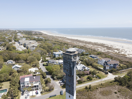 The modern monolithic Sullivan's Island Lighthouse, the last major lighthouse built by the federal government, resembles an air traffic control tower more than a traditional lighthouse. The tower's unique triangular shape, with one point directed towards  報道画像