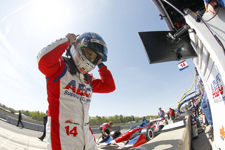 TONY KANAAN (14) of Brazil gets suited up and strapped into his machine to take to the track for final practice for the Honda Grand Prix of Alabama at Barber Motorsports Park in Birmingham, Alabama. Redakční