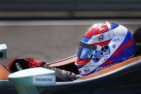 ZACH VEACH (26) of the United Stated gets suited up and strapped into his machine to take to the track for final practice for the Honda Grand Prix of Alabama at Barber Motorsports Park in Birmingham, Alabama. Editorial