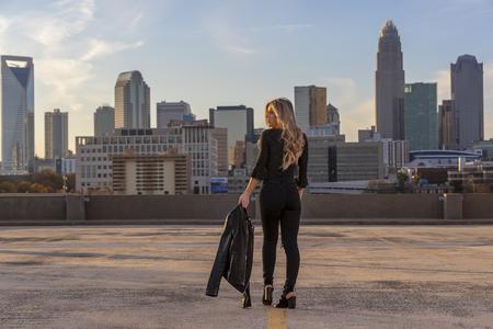 A beautiful blonde model posing outdoors in an urban environment 写真素材