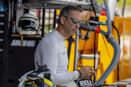 WeatherTech Prototype driver, Joao Barbosa, relaxes before the start of the Acura Sports Car Challenge at Mid Ohio Sports Car Course in Lexington, Ohio.