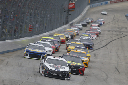 Kevin Harvick (4) battles for position during the AAA 400 Drive for Autism at Dover International Speedway in Dover, Delaware.