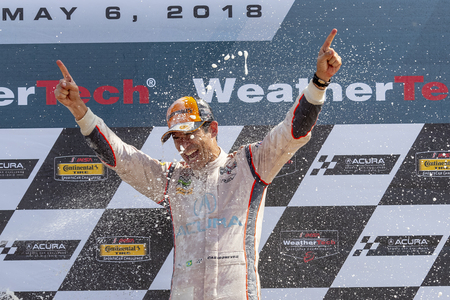 Hello Castroneves (BRA) is showered with champagne from his fellow racers after winning the Acura Sports Car Challenge at Mid Ohio Sports Car Course in Lexington, Ohio.