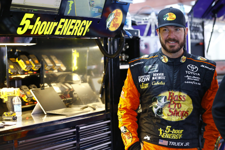 Martin Truex, Jr (78) hangs out in the garage during practice for the GEICO 500 at Talladega Superspeedway in Talladega, Alabama. Editorial