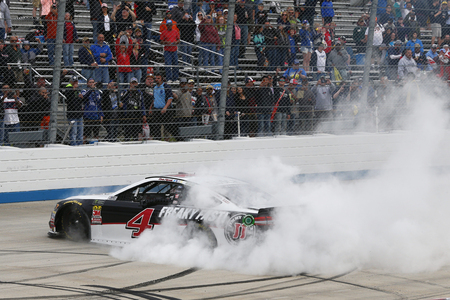 Kevin Harvick (4) celebrates after taking the checkered flag and winning the AAA 400 Drive for Autism at Dover International Speedway in Dover, Delaware.
