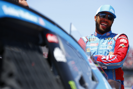 Darrell Wallace, Jr (43) hangs out on pit road before qualifying for the GEICO 500 at Talladega Superspeedway in Talladega, Alabama.