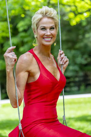 A beautiful mature blonde model posing in an outdoor environment