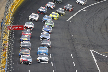May 27, 2018 - Concord, North Carolina, USA: Kyle Busch (18) leads the field for the Coca-Cola 600 at Charlotte Motor Speedway in Concord, North Carolina.