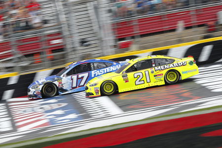 May 27, 2018 - Concord, North Carolina, USA: Ricky Stenhouse, Jr (17) and Paul Menard (21) battle for position during the Coca-Cola 600 at Charlotte Motor Speedway in Concord, North Carolina.
