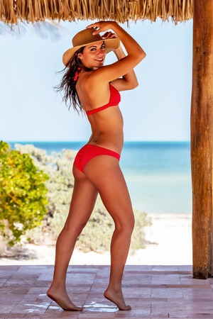 A beautiful hispanic brunette model enjoying a day outdoors