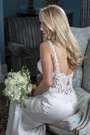 A beautiful blonde bride posing for her bridal portraits