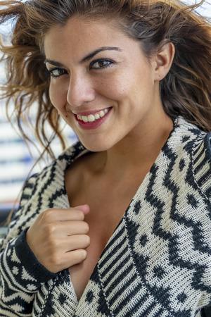 A hispanic brunette model lounging around on a resort Stockfoto