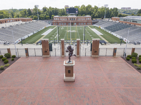 UNC Charlottes Division I FCS football team kicked off in 2013. It plays at Jerry Richardson Stadium, which holds approximately 15,000 people and can be expanded to hold up to 40,000 people. Its first game was a 52-7 victory against Campbell University o