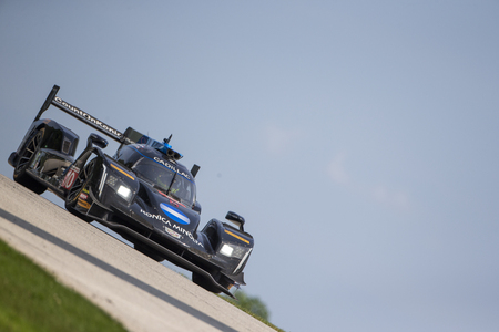 August 05, 2018 - Elkhart Lake, WI, USA:  The Konica Minolta Business Solutions USA Cadillac DPI car races through the turns at the Continental Tire Road Race Showcase at Road America in Elkhart Lake, WI.
