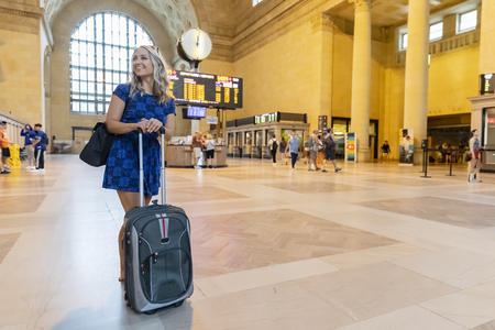 A beautiful blonde model enjoys a day traveling on mass public transit